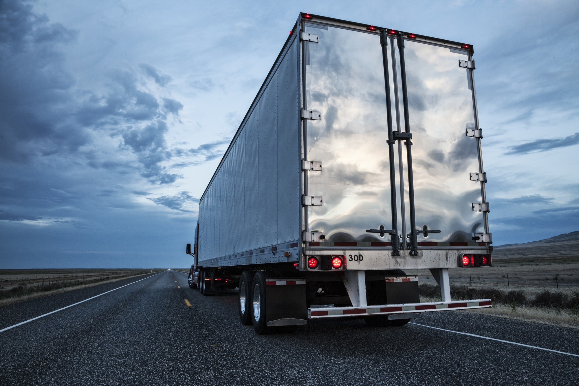 rear-view-of-the-trailer-on-a-class-8-commercial-truck-on-the-highway-.jpg